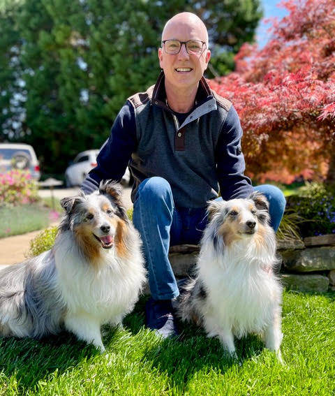 Tim with his pups